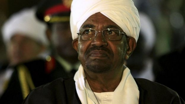 Sudan's President Omar al-Bashir looks on before addressing the nation on the eve of the 60th anniversary of its Independence Day at the presidential palace in Khartoum