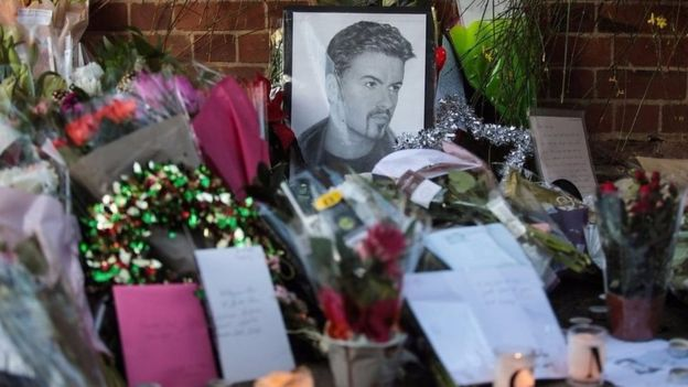 Fans and friends of George Michael have been leaving tributes outside his home in Highgate, North London.