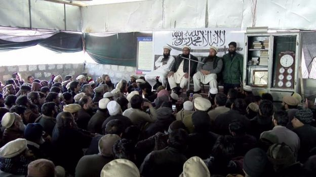 Hafiz Saeed (second from left) addresses activists in Muzaffarabad 11 January