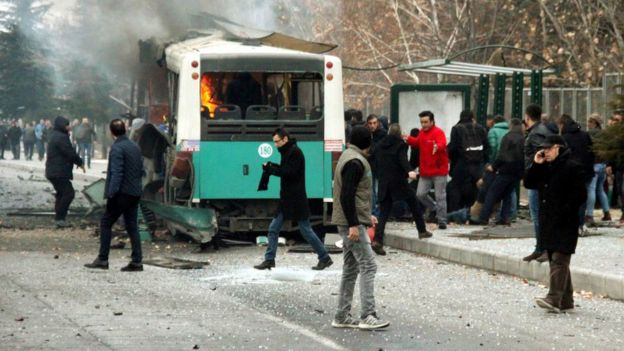 People react after a bus was hit by an explosion in Kayseri, Turkey, December 17, 2016.