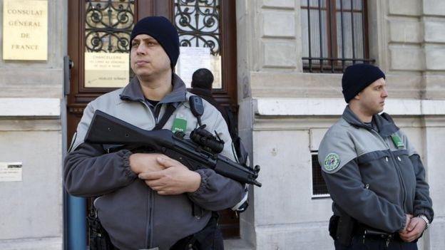 Armed guards outside French consulate in Geneva, Switzerland, Friday, Dec 11, 2015