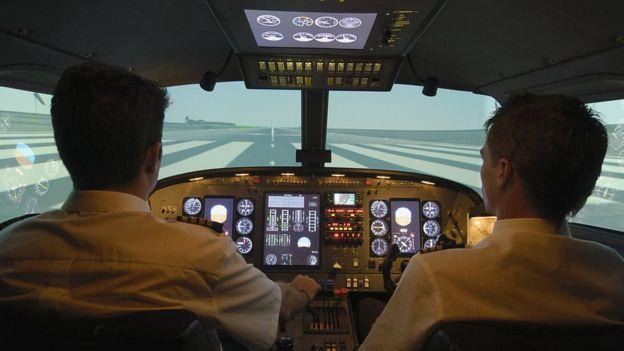 pilotos en un avión