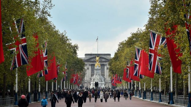 British Union flags and Chinese flags fly together on the Mall in central London