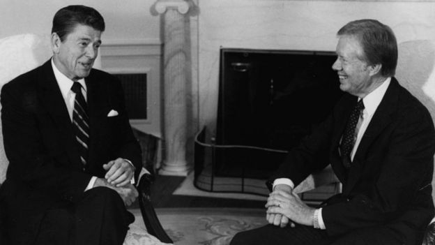 President Ronald Reagan (left) talks to former President Jimmy Carter at a meeting regarding the AWACS sale of planes to Saudi Arabia, in the Oval Office of the White House, Washington DC, October 13th 1981