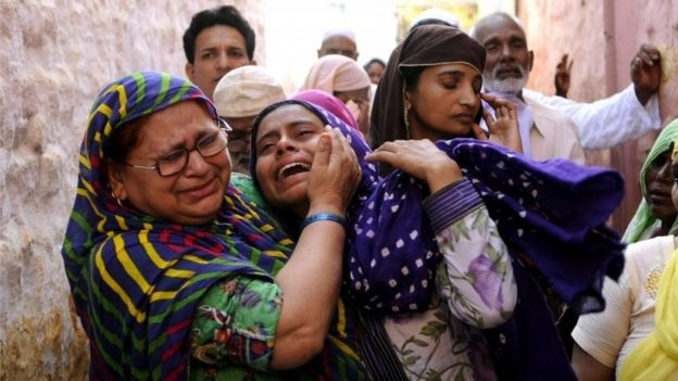 Relatives mourn slain Indian villager Mohammad Akhlaq in the village of Bisada, some 35 kilometres (22 miles) north-east of New Delhi,