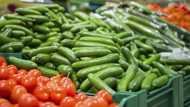 A mound of cucumbers in a supermarket