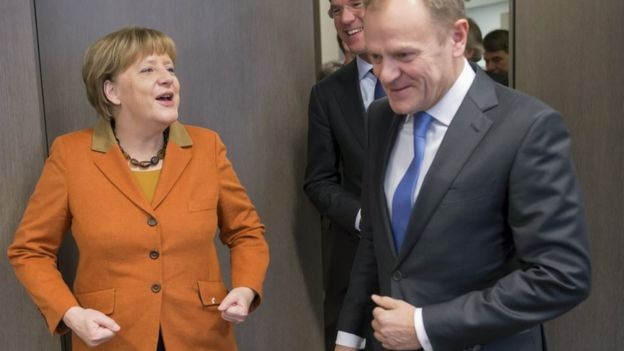 German Chancellor Angela Merkel and European Council President Donald Tusk attend a bilateral meeting during a EU-Turkey summit in Brussels