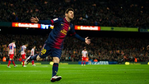 Footballer Lionel Messi celebrates scoring a goal for his side, Barcelona