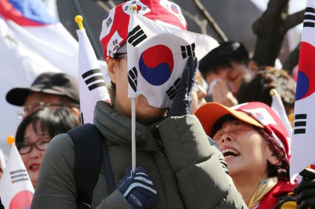 A supporter of South Korean President Park Geun-hye weeps during a rally opposing her impeachment near the Constitutional Court in Seoul, South Korea, Friday, 10 March 2017.