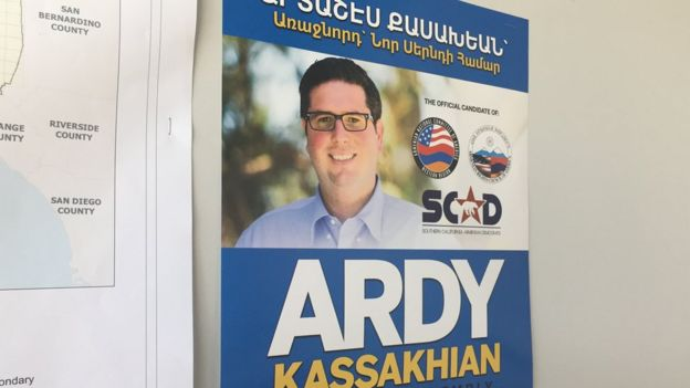An Armenian-language Ardy Kassakhian sign hangs in his campaign headquarters.