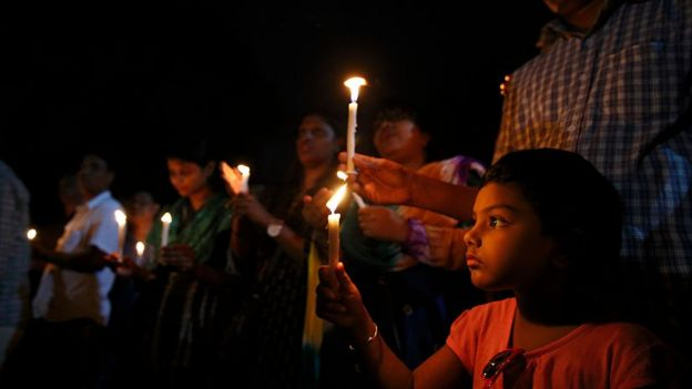 People take part a candle-light vigil organised by Sammilito Sangskritik Jote, an organisation of cultural activists, at Central Shaheed Minar to remember the victims of the Gulshan cafe attack on July 3, 2016 in Dhaka, Bangladesh.