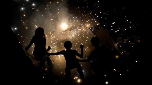 Indian children light fireworks in New Delhi