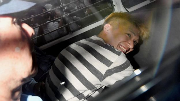 Satoshi Uematsu, suspected of a deadly attack at a facility for the disabled, is seen inside a police car as he is taken to prosecutors, at Tsukui police station in Sagamihara, Kanagawa prefecture, Japan, in this photo taken by Kyodo July 27, 2016.