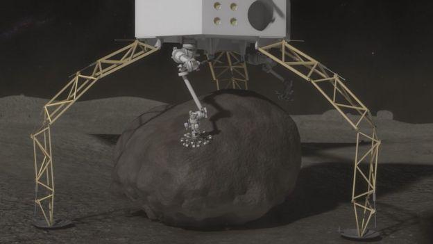 Una sonda recogiendo una enorme roca