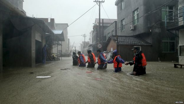 Rescue workers in flooded street in Ningde, Fujian province - 9 August