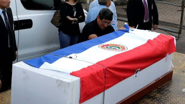 Feliciano Encina, father of Gustavo Encina, Paraguayan pilot of the crashed plane that carried the Brazilian team Chapecoense, cries next to the coffin of his son at the Silvio Pettirossi International Airport in Luque, Paraguay 2 December 2016.