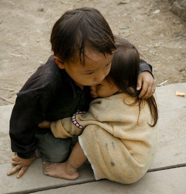 Picture of two children hugging