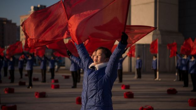 A propaganda troupe perform before the Arch of Triumph on the last day of the 200-day mass mobilisation campaign in Pyongyang on December 15, 2016