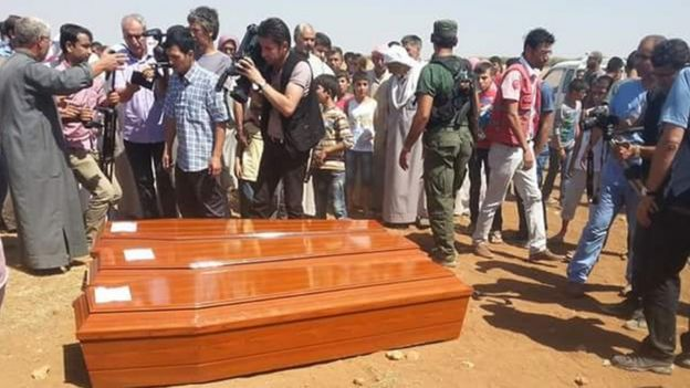 Coffins bearing the bodies of Alan Kurdi and other members of his family