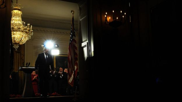 US President George W. Bush leaves after delivering ha final farewell speech to the nation at the East Room of the White House in Washington, DC, on January 15, 2009. In a sober farewell address, Bush has celebrated the 'hope and pride' Barack Obama inspires and urged an often divided America to unite to overcome terrorism and economic crisis. Obama, due to become the first black US president on January 20th, is 'a man whose history reflects the enduring promise of our land,' Bush said in what was due to be his last televised speech to the nation he led for eight years