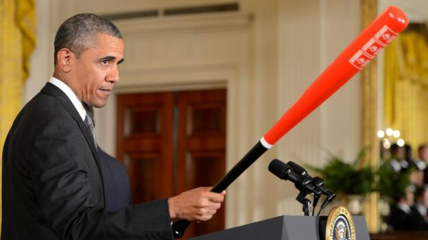 Obama con un bate de beisból