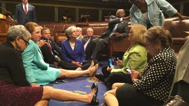 Congressmen sitting on the floor of the House