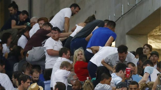 Fans in Marseille stadium climb fences to escape trouble
