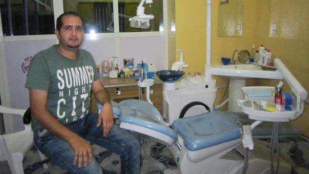A Syrian dentist sits in his consulting room in Hargeisa, Somaliland