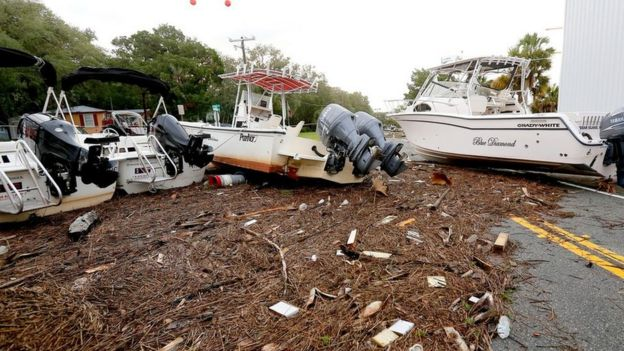 Debris and boats are scattered across the road after Hurricane Hermine passed the area on Friday, 2 September 2016 in Steinhatchee, Fla.