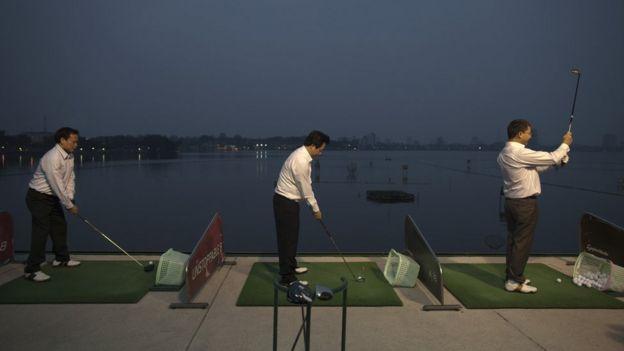 Men playing golf in Hanoi
