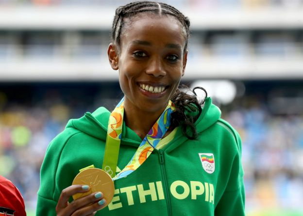 Almaz Ayana of Ethiopia poses with the gold medal for the Women's 10,000 Meters Final after setting a new world record of 29:17.45 on Day 7 of the Rio 2016 Olympic Games
