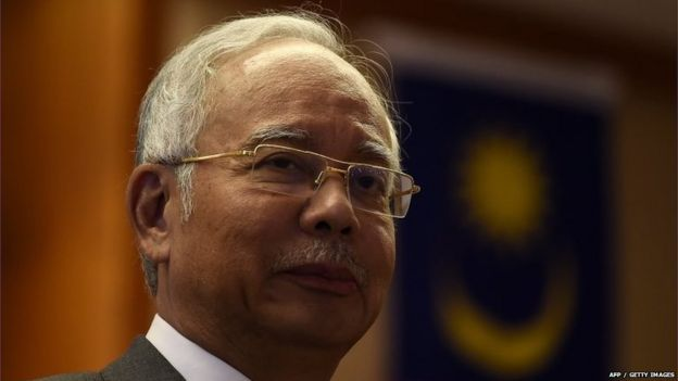 Malaysian Prime Minister Najib Razak looks on during a meeting for new government interns at the Prime Minister