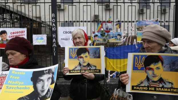 Protesters hold pictures of Nadiya Savchenko during a protest outside the Russian embassy in Kiev, Ukraine. Photo: 22 March 2016