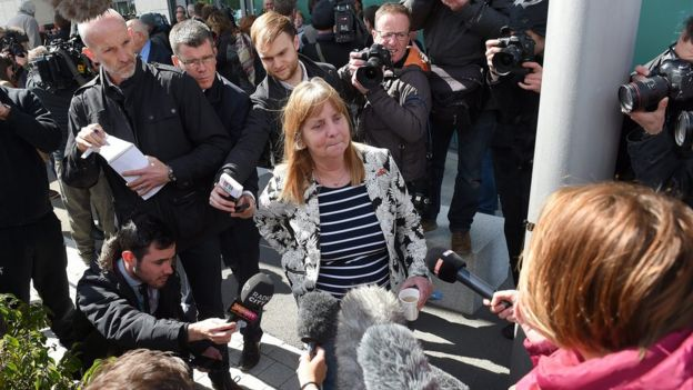 Margaret Aspinall reacts outside court