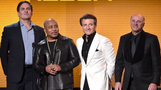 Shark Tank cast members Mark Cuban, Daymond John, Robert Herjavec, and Kevin O'Leary speak onstage at the 2014 American Music Awards