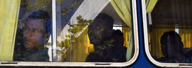 Migrants looks out from a bus after arriving at the port of Kalamata in South Peloponnese, Greece, 17 April 2016