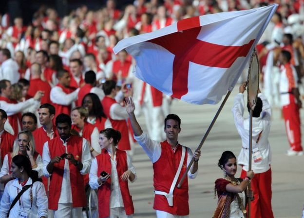 England athletes led by flagbearer Nathan Robertson take part in the opening ceremony of the XIX Commonwealth Games in New Delhi on October 3, 2010