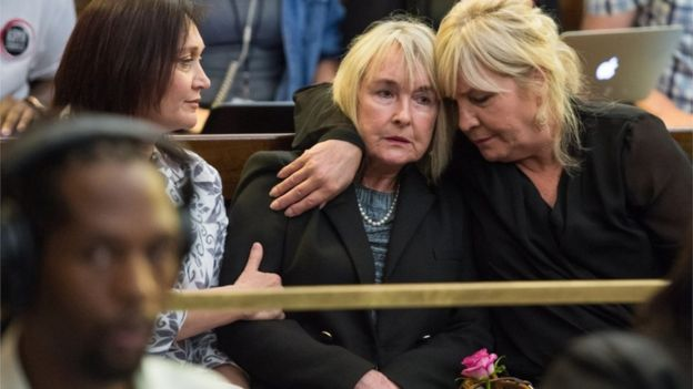 June Steenkamp (C) the mother of Reeve Steenkamp, is comforted as judge Eric Leach (not in picture) reads out the court finding