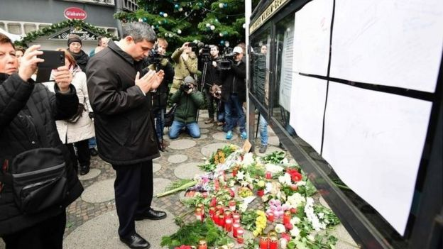 People pay tribute to victims of Berlin attack on 20 December