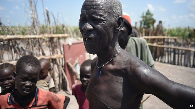 South Sudanese man whose home was burned by soldiers and militiamen.