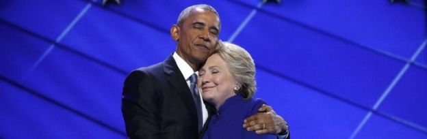 US President Barack Obama greets Democratic presidential nominee Hillary Clinton at the end of the third day of the Democratic convention.