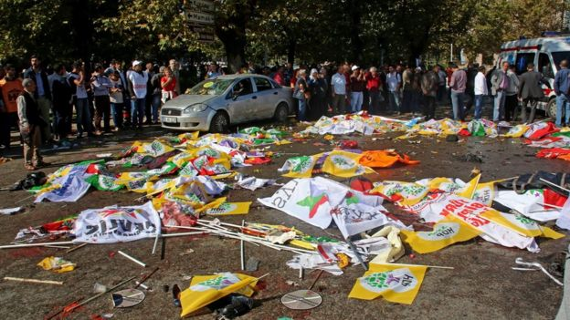 Victims' bodies covered in banners after multiple explosions before a rally in Ankara, Turkey 10 October 2015.