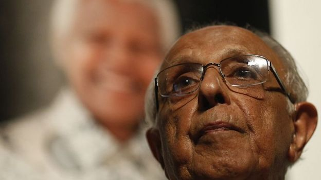 Anti-apartheid activist and close friend of former South African President Nelson Mandela, Ahmed Kathrada, talks during a tribute to Mandela at Gandhi Hall, on December 8, 2013