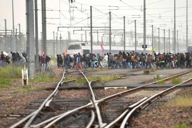 Protesters cross railway tracks at Rennes, 26 May