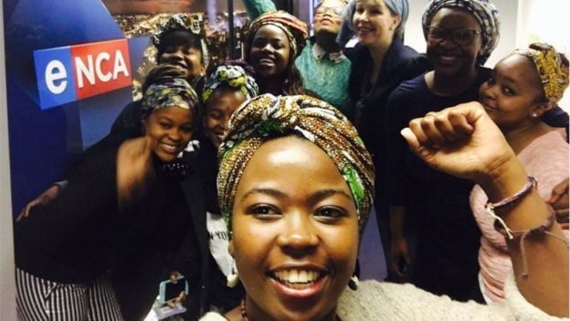 Reporters in the ENCA newsroom, showing their support for colleague Nontobeko Sibisi (F)