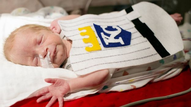 Baby in a Kansas City Royals baseball team outfit
