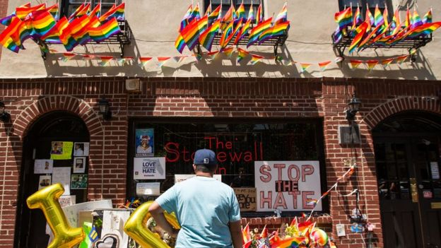 A man stops in front of the Stonewall Inn on June 24, 2016 in New York City.