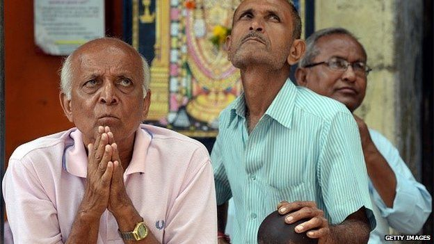 Indian investors watch the stock exchange