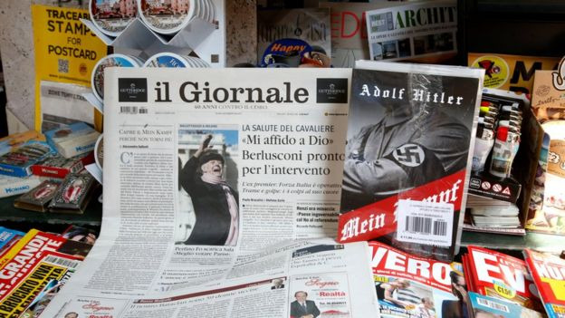 Il Giornale newspaper is seen on sale in a newsstand with Hitler's