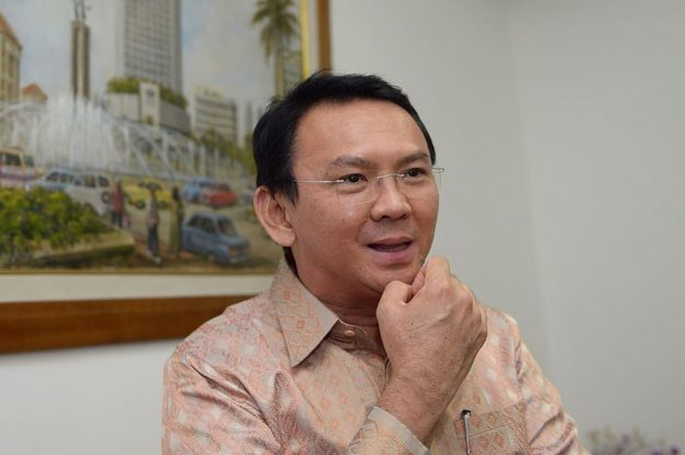 Basuki Tjahaja Purnama, known by his nickname Ahok, speaks to journalists at his office in Jakarta in 2014